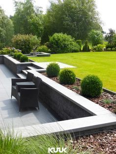 Sloped garden Tiered garden Garden steps Hillside landscaping Garden Garden wall - A beautiful combination of a modern and sleek terrace due to the anthracitecolored pavement and a natural and sp - Back Garden Design, Modern Garden Design, Backyard Garden Design, Patio Design, Backyard Patio, Wall Design, Pavers Patio, Patio Stone, Patio Wall