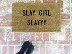 """A doormat that says, """"You're welcome to enter MY home."""" Pictured: $38 ShopJosieB """"Slay girl slayyy"""" Outdoor Mat"""