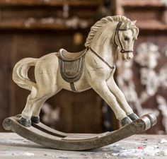 Vintage old rocking horse on a wooden background stock photo