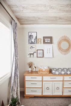 A low, vintage dresser becomes the ideal changing table with the addition of painted drawers and new hardware.