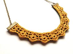 Were excited about sharing our brand new design with you! This saffron shells-in-a-row lace bib necklace is sure to set you apart from the