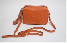 Gucci Disco Orange New Cross Body Bag. Get the trendiest Cross Body Bag of the season! The Gucci Disco Orange New Cross Body Bag is a top 10 member favorite on Tradesy. Save on yours before they are sold out!