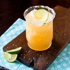 Orange Margarita:  6 oz homemade margarita mix  6 oz fresh squeezed orange juice  6 oz silver tequila  4 oz orange liqueur (we love Paula's Orange)  Sugar, for rimming glasses (optional)