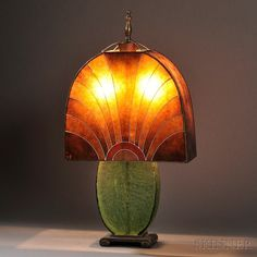 """Art Deco Table Lamp. Mica, glass, metal, enamel. Probably France, c. 1920. Shade composed of mica panels enameled w/ abstract geometric sun motif, over a double socket raised on a green crackle glass base w/ cast metal scrolled foot, base stamped 1510, H. 24 1/2"""" (hva)"""