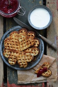 A cute little breakfast for two idea. Heart shaped waffles with a side of homemade jam.