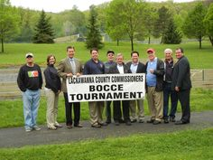 The Lackawanna County Commissioners gather with organizers of this year's 22nd annual Commissioners' Bocce Tournament, which will be held on Saturday, June 8, from 9 AM to 7 PM at McDade Park, Scranton. The event will feature 24 teams with over 100 players in men's, women's and mixed teams categories. For information, contact John Rettura at (570) 961-2335 or the McDade Park Office at (570) 963-6764.