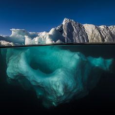 Photo by @DavidDoubilet Icebergs are fluid sculptures in the sea and a perfect metaphor for the oceans because only a small percentage is visible to our human eye. We dove in a garden of icebergs near Red Island in #Scoresbysund Fjord #Greenland. It was an Alice in Wonderland moment sadly created by the rapid unprecedented  retreat of Greenland's glaciers. #Toronto Jan 26 join us and Celebrate Photography Under the Sea and Explore Life in the Ice with @natgeo Live. With @natgeocreative…