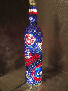 GO CUBS! Cheer for the Chicago Cubs all year long with this hand-painted lighted wine bottle. All bottles are hand-painted and designed to ensure they are one of a kind.