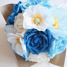 A bouquet of blue tea roses, white Japanese anemones, cream roses, and soft blue Icelandic poppies  . #bluebouquet #blueflowers #blueroses #blue #handmadeflowers #handmadebouquet #paperbouquet #crepepaper #italiancrepepaper #paperflorist #paperflowers #paperroses #tearoses #japaneseanemones #bluepaperflowers #bluepaperbouquet #itsallpaper #craftedinsg #handmadeinsg #sgcrafters #sgcrafts