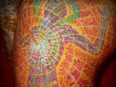 Vibrant Alex Grey tattoo.