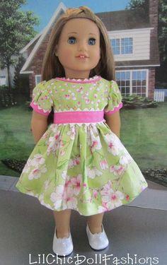 Like the rick rack detail.  American Girl in her pretty green & pink dogwood print dress.