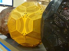 LASER CUT LAMPS At the ICFF in New York, the process of making laser cut metallic lamps was shown, complete with the machinery that was needed. Laser cut equipment by US.Trumpf. Lighting design by Tom Dixon. Photo by Milou Ket.