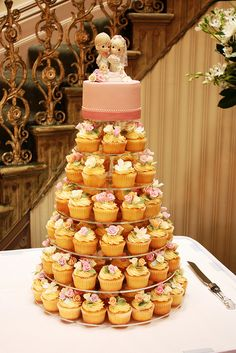 Queenie's wedding cupcake tower by Cake Ink. (Janelle), via Flickr