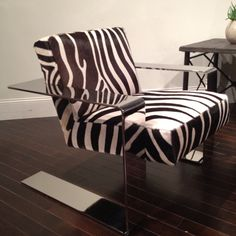 Conner chair polished chrome frame upholstered in zebra hair on hide. The suspended frame offers a rocking effect Bernhardt IHFC 601 Home Decor Furniture, Home Furnishings, Modern Furniture, Furniture Design, Zebra Chair, Piano Room, Interior Design Business, Take A Seat, Chairs For Sale