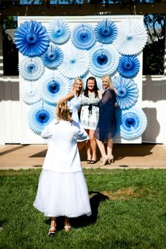 Hang large spiral paper flowers on a wall to provide a fun spot for photo opportunities. As an alternative, hang these paper flowers behind a table to create the backdrop for a beautiful dessert bar.