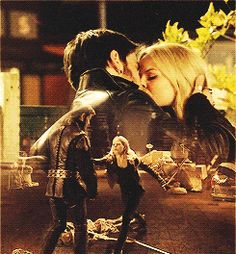 """Emma and Killian.""""In 2.03, Emma tearfully said to her mother that she wasn't used to someone putting her first. And while I applaud Snow for telling her daughter to """"get used to [being put first],"""" the person who truly and unequivocally puts Emma Swan as the highest priority in their life doesn't appear until the next episode and doesn't even meet her until the episode after that: Killian Jones."""""""