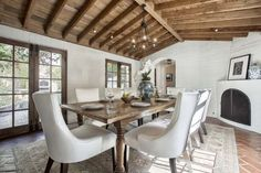 Fine Dining - Rustic wood, white-brick walls, and wrought iron accents turn a basic dining room into an intimate gathering spot. Mexican Style Homes, Hacienda Style Homes, Katharine Hepburn, Beverly Hills, Bali, White Brick Walls, Rustic Fireplaces, Outdoor Fireplaces, Storey Homes