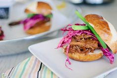Pulled pork sliders with pickled cabbage slaw. In a crockpot, so super easy!
