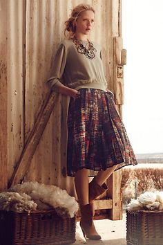 Casual and feminine with the flirty skirt, boots and sweatshirt-like top #stitchfix Abstracted Plaid Skirt - anthropologie.com