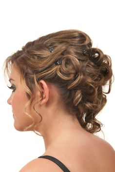 Pin Curled Updo. Sections are twisted up every which way and held in place with tiny hair clips.