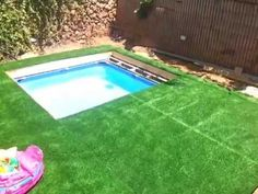 Man Builds DIY 'Hidden Pool' In His Backyard That Disappears Under a Grass-Covered Top When Not in Use