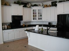 White Cabinets with Black Granite Countertops and Black Appliances Idea #contemporarykitchencabinetssimple