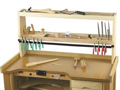 "BenchTop Organizer Store pliers, shears, burs, files and other tools within easy reach. Notchedto sit over the rear railing for no-tip support, this organizer fits on anyworkbench with a 35"" or wider top. • 1/2"" and 1/4"" holes hold files, awls or gravers at an accessible angle. • 35""W x 6""D x 17""H (depth tapers to 5"" at the top). • hardwood construction; assembly required (all hardware is included). • includes heavy-duty box for safe shipping."