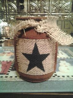 Grubby candle jar I made with a burlap star label.