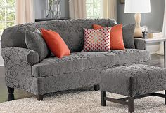 Stretch Jacquard Damask Slipcovers, Gray is the new decorator color for 2013 that's now available in this timeless favorite. The regal pattern makes a textural statement with an exquisite raised design.