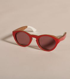 Commune de Paris has teamed up with sunglass brand Waiting for the Sun, releasing a trio of wood framed shades. The capsule collection is presented alongside the 2013 Spring/Summer collection and is composed of Commune de Paris versions of the Deux model.  The wooden frames are bedecked with engraved details and offered in bright summer colours. The outer side of the frames is painted in yellow, blue, or red gloss and the lenses (Carl Zeiss) are tinted accordingly.