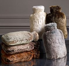Luxe faux fur hot water bottle. Say goodbye to frozen feet and cold sheets with these luxuriously soft hot water bottles. You may actually start to love winter nights snuggled up with homemade hot chocolate! Restoration Hardware