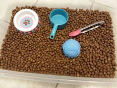 """Dog food"" sensory bin Use cocoa puffs cereal instead of dog food"