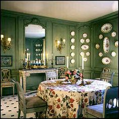 wood paneling gets painted green in this traditional dining room