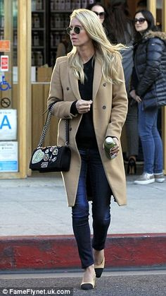 Spot the bump? Earlier this month, Nicky was seen out and about in Beverly Hills, wearing ...