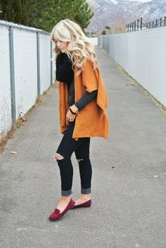 pumpkin shawl, grey long sleeved tee, black chunky scarf, dark wash ripped skinnies and burgundy flats.