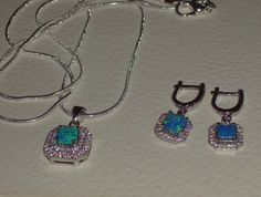 LOOK!!! A STERLING SILVER PAIR OF BLUE FIRE OPAL AND AAAAA CZ EARRINGS AND MATCHING NECKLACE