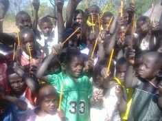 The Pencil Project - an organization which links givers with children and schools in need of pencils for education. This is a picture of children of the Lundazi Village holding their Pencil Project gifts.