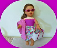 Cute bathing suit set with handmade sarong, beach bag, bathing suit and towel.  Sunglasses included!   #agbeachset #americangirlswimsuit #18inchdollbathingsuit #dollsummervacation