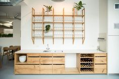 Oak was chosen as the main material throughout the space, to match the barrels