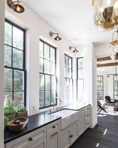 White kitchen with black steel windows | See this Instagram photo by @beckiowens
