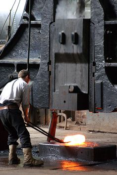Forging with a large Steam Hammer.