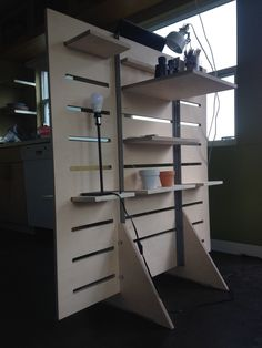 This is our standup desk with multiple configurable shelves for storage on both sides. They're made to be adjustable and versatile to match your work style, an Storage Shelves, Shelving, Nomadic Furniture, Folding Desk, Stand Up Desk, Lap Desk, Wood Display, Wooden Desk, Home Organization