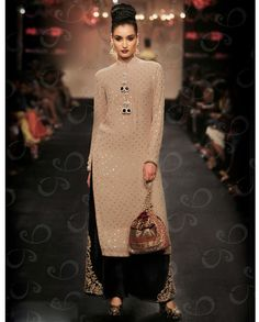 Beige and black long suit with zari embroidered bottom   1. Beige and black georgette long suit2. Comes with matching bottom and dupatta3. Can be stitched upto size 42 inches