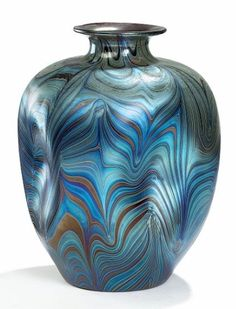 ❤ - Loetz | Art nouveau vase of iridisent glass with typical swirling pattern in blue, purple and copper. Made by and with engraved signature Loetz, Austria. Circa 1900.