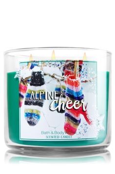 """Alpine Cheer - 3-Wick Candle - Bath & Body Works - The Perfect 3-Wick Candle! Made using the highest concentration of fragrance oils, an exclusive blend of vegetable wax and wicks that won't burn out, our candles melt consistently & evenly, radiating enough fragrance to fill an entire room. Topped with a silver, snowflake-embossed lid! Burns approximately 25 - 45 hours and measures 4"""" wide x 3 1/2"""" tall."""