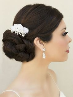 Small rhinestone, crystal and freshwater pearl bridal hair comb in a low bridal bun by Hair Comes the Bride. Perfect for your romantic or bohemian wedding day bridal look.