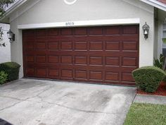 New house ideas on pinterest red doors red front doors for How to paint a garage door to look like wood