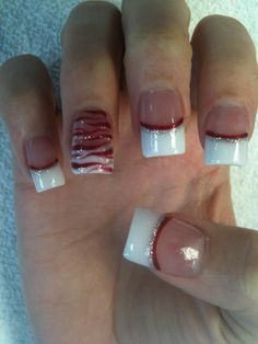 French tips with silver and red lines. Pretty basic, same pattern for each nail. @kelseymason I found you!!!