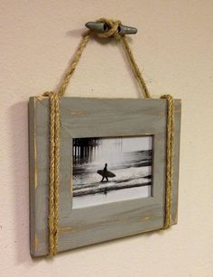 Driftwood frame with rope accents..hangs from a boat cleat!