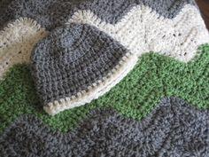 Handmade ripple/chevron baby blanket in green, gray, and cream with matching newborn hat